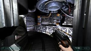 Screenshot of a corridor in Doom 3 running in widescreen.
