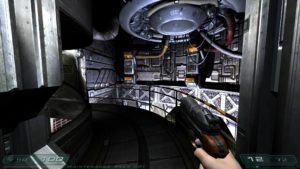 Screenshot of a corridor in Doom 3 running in widescreen.